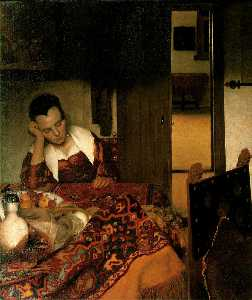 Girl asleep at a table