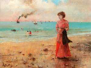 Young woman with red umbrella on the beach