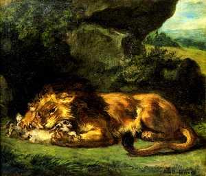 León devorando un conejo