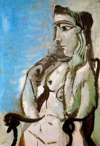 Naked woman in an armchair