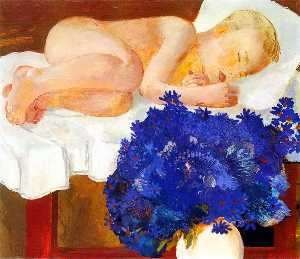 Sleeping baby with cornflowers