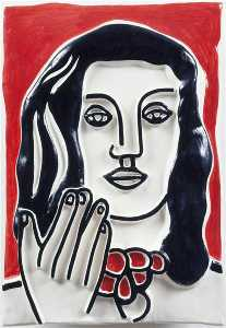 Face by hand on a red background