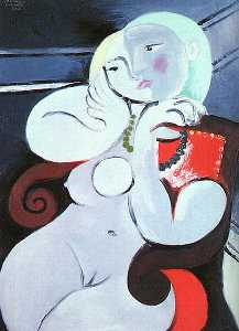 Female nude sitting in red armchair