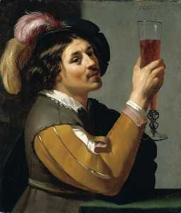 Young Man Drinking a Glass of Wine