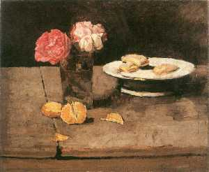 Roses, orange and biscuits on a plate