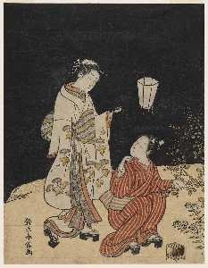 Young Man And Woman Hunting For Insects At Night