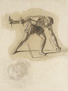 Crouching Male Figure Holding Staff