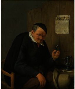 An Elderly Man Seated Holding A Wineglass