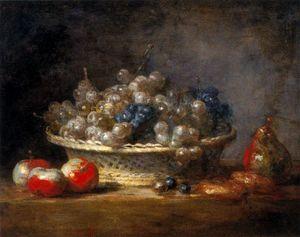 Corbeille de raisins avec trois pommes d'api, une poire et deux massepains