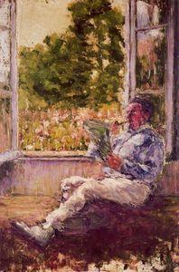 Man sitting beside a window