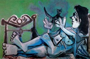 Naked woman playing with a cat