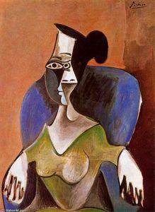 Woman sitting in an armchair