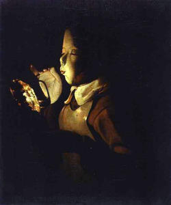 Boy blowing at a Lamp