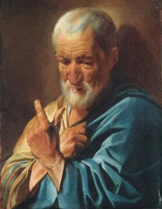 An old man with a raised finger