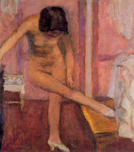 Nude woman bending down