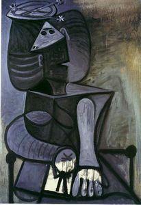 Seated woman with flat hat