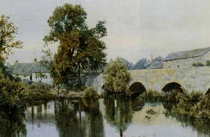 A Stone Bridge Leading Into Village