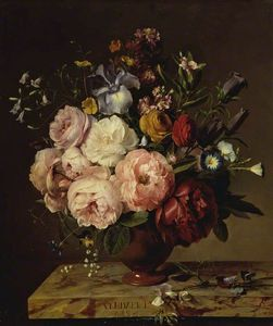 A Vase Of Flowers On A Ledge