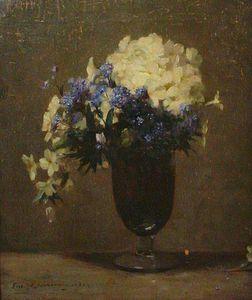 Primroses In A Glass Vase