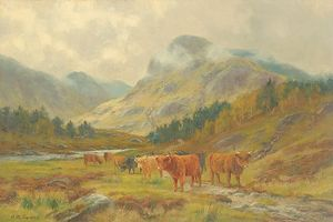 Highland Cattle Grazing In A Mountain Landscape With Low Clouds