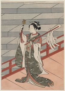 Shinto Priestess (miko) Dancing At A Shrine