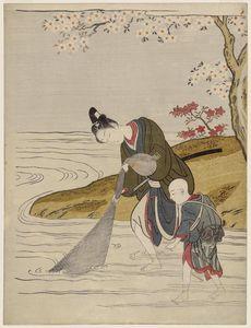 Young Man Hauling In A Fishing Net