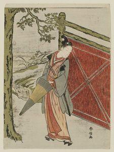 Young Man With Umbrella à côté d une clôture