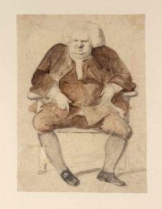 un homme assis dans un fauteuil