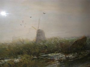 Cows In A Pasture With Two Windmills