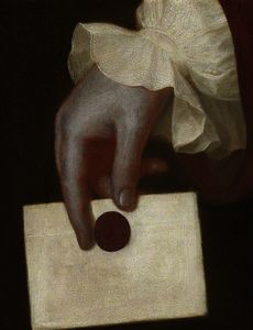 A Hand Holding a Letter