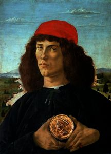 Portrait of a young man holding a medallion of Cosimo I de' Medici