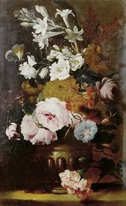 Roses, jasmine, primroses and other flowers in an urn on a table top
