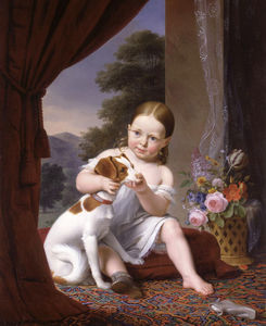 A young girl seated with her dog