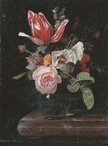 Roses, peonies, a tulip and other flowers in a glass vase on a stone ledge