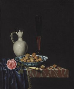 A wan-li bowl with walnuts, a façon de venise wine glass, an ivory-handled knife, a Delft stoneware jug and a rose on a partially draped marble ledge