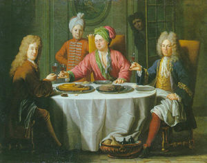 Gentlemen meeting around a table in an interior