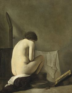 Seated nude bathing by a stove